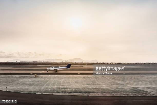 stationary light aircraft on runway, lima, peru - lima stock-fotos und bilder