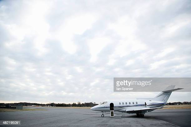 Stationary private jet on airport runway