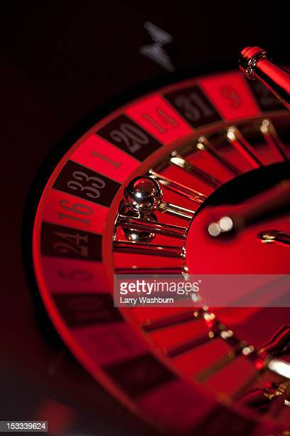 A stationary roulette wheel with the ball on number 33