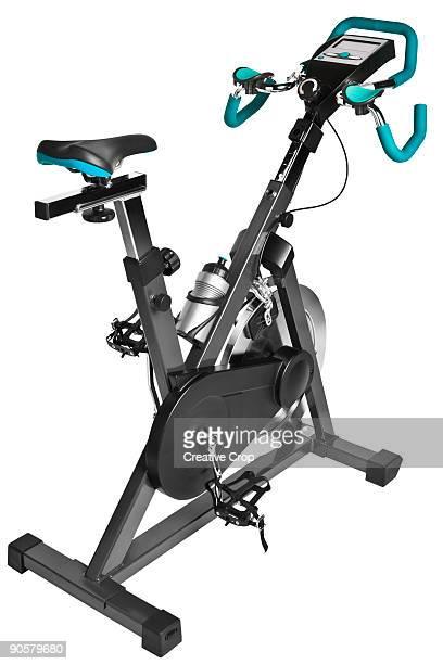Stationery spinning exercise bike