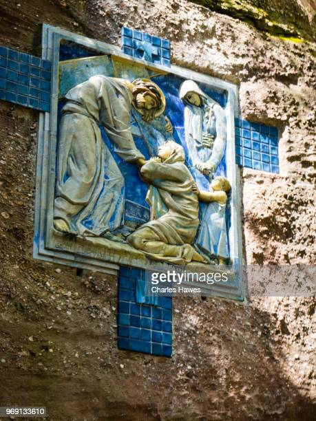 stations of the cross ceramics on cliff face approaching the mont saint odile abbey. images taken in the alsace region of france between andlau and obernai - stations of the cross stock pictures, royalty-free photos & images