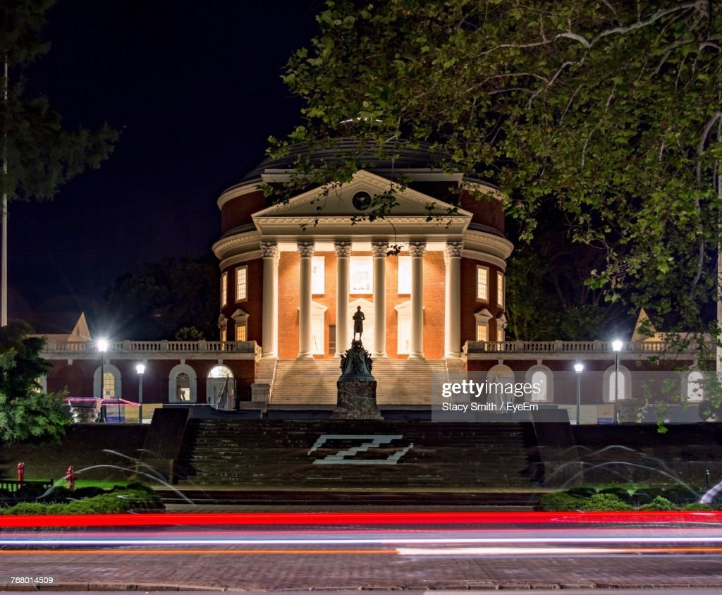 Statue Against Building At Night : Stock Photo