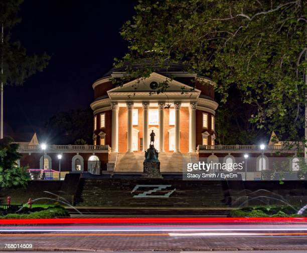 statue against building at night - charlottesville stock pictures, royalty-free photos & images