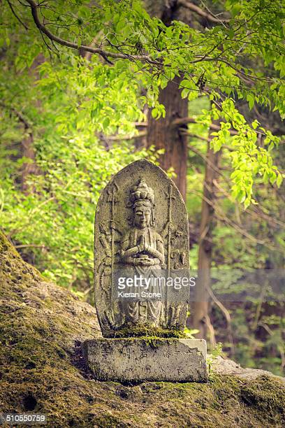Statue along the hiking path that leads to the temple grounds of Yamadera Yamagata City Japan