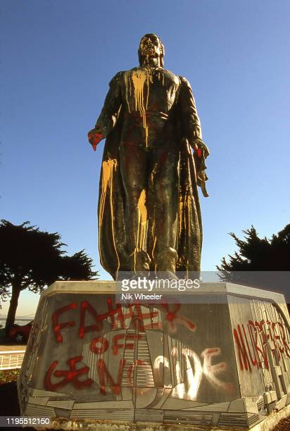 A statue and monument to explorer Christopher Columbus is defaced with antiColumbus slogans and graffiti in city of San Francisco circa 1980
