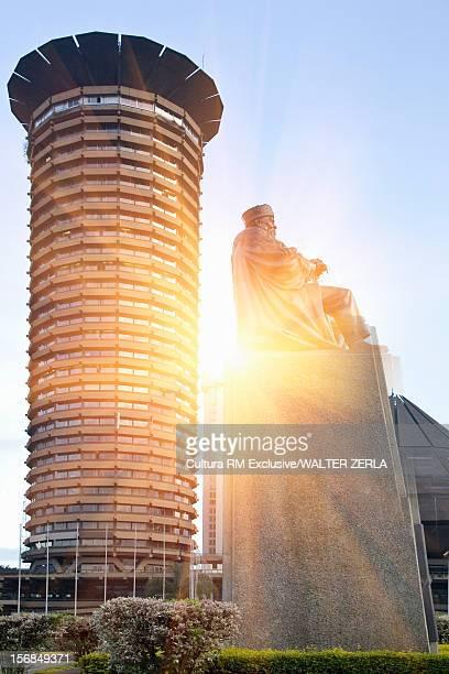 Statue and skyscraper in city center