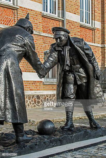 Statue by Andrew Edwards representing British and German soldiers shaking hands during World War One Christmas Truce on the Mesen / Messines market...