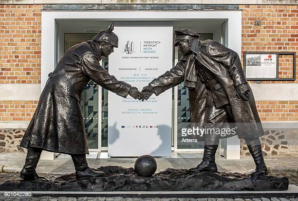 Statue by Andrew Edwards representing British and German soldiers shaking hands during World War One Christmas Truce in front of the Mesen / Messines...