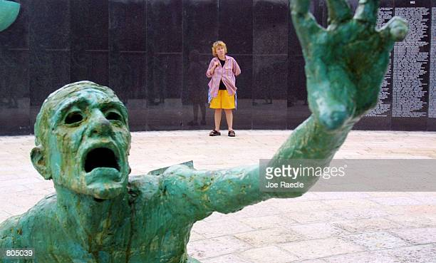 A statue by artist Kenneth Treister is on display as part of a sculpture depicting thousands of victims crawling into an open hand representing...