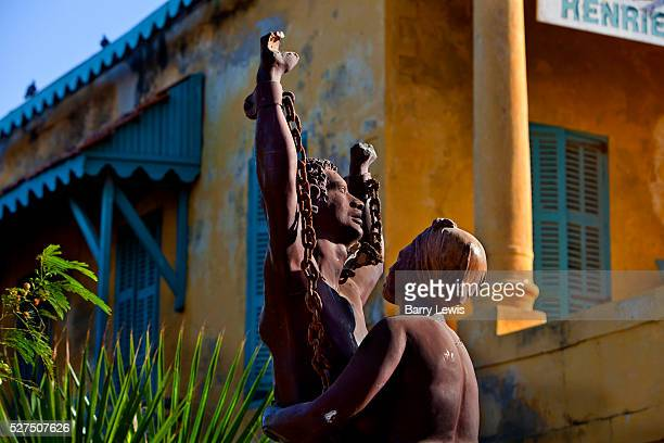 A statue celebrating the liberation of slaves near the House of Slaves Goree island Senegal Gor��e is both the smallest and the least populated of...