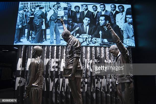 A statue commemorating the 1968 Olympics Black Power salute is on display during a press preview at the Smithsonian's National Museum of African...