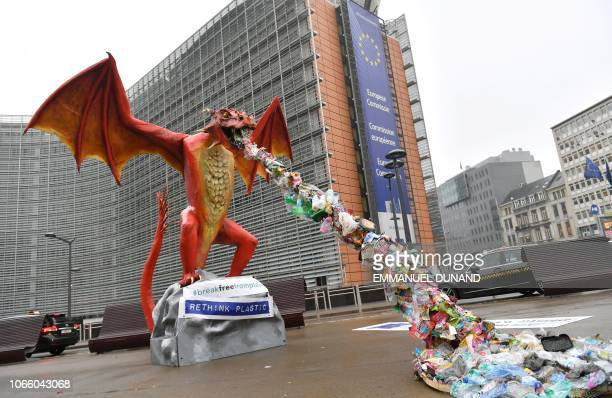 TOPSHOT A statue depicting a plasticthrowing dragon is set up in front of the European Commission during an action by NGO alliance Rethink Plastic to...