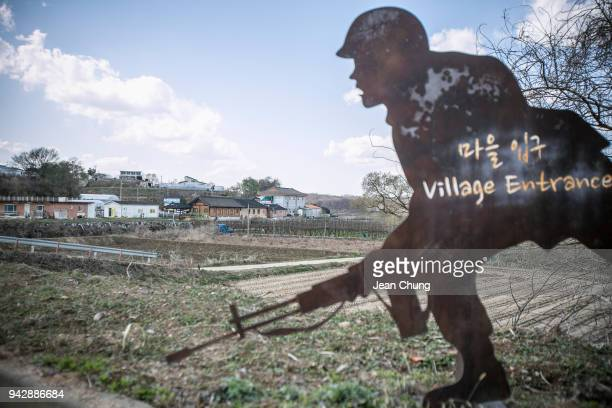 A statue depicting a South Korean soldier stands at the entrance of the Unification Village inside the fortified Demilitarised Zone on April 7 2018...