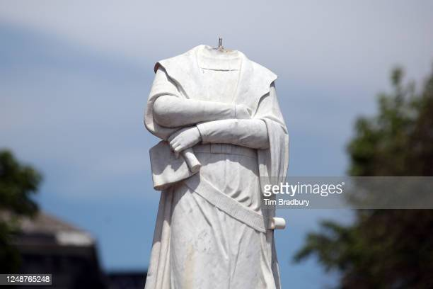 A statue depicting Christopher Columbus is seen with its head removed at Christopher Columbus Waterfront Park on June 10 2020 in Boston Massachusetts...