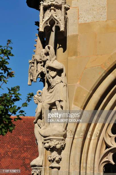Statue depicting Jesus Christ as the Good Shepherd with a lamb on his shoulders exterior of the church of St James Rothenburg Ob Der Tauber Middle...