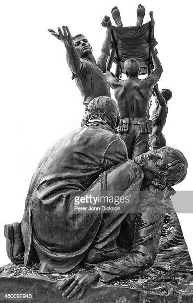 CONTENT] A statue depicting the horror of war and disaster The rescuers are helping and trying to save and help the victims by using a stretcher and...