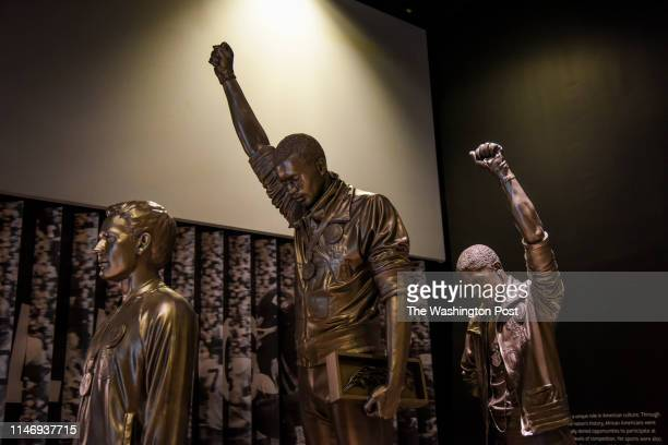 Statue depicting USA track and field athletes Tommie Smith, C, and John Carlos, R, as they raised gloved fists during their medal ceremony at the...