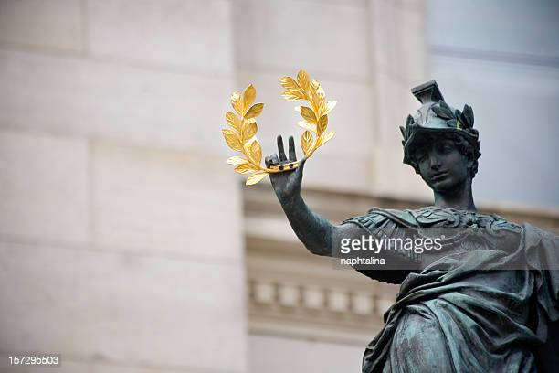 Statue holding a golden laurel