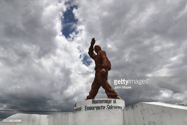 A statue Homage to the Migrant stands over a traffic circle on August 8 2018 in Salcaja Guatemala The statue honors the thousands of citizens of...