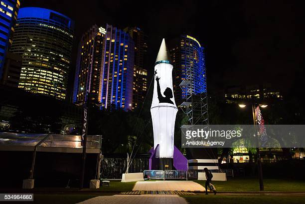 A statue illuminated with lights displaying different colors and shape within the activities of 'Vivid Sydney' on May 28 2016 in Sydney Australia...