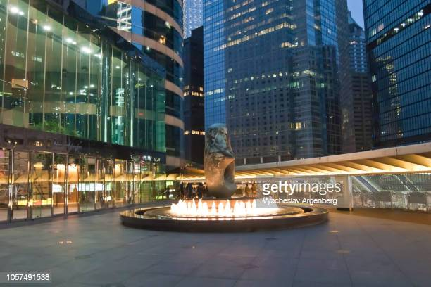statue in central hong kong, city lights at night - hong kong stock pictures, royalty-free photos & images