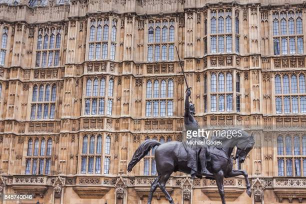 Statue in front of houses of Parliament in Westminster