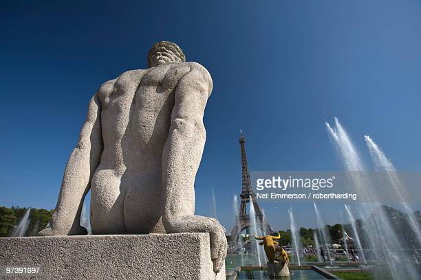 Statue in front of the Eiffel Tower, Paris, France, Europe