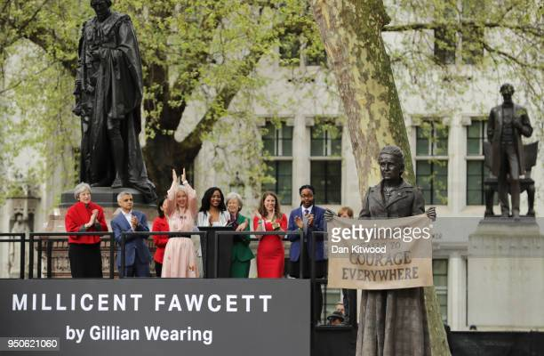 A statue in honour of the first female Suffragist Millicent Fawcett is unveiled as British Prime Minister Theresa May and Mayor of London Sadiq Khan...