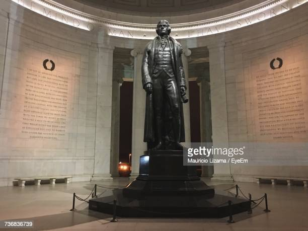 statue in illuminated room - jefferson memorial stock pictures, royalty-free photos & images