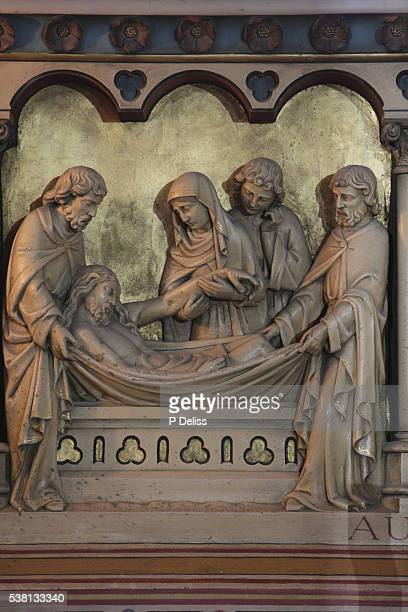 statue in notre-dame de paris cathedral. jesus's entombment - stations of the cross stock pictures, royalty-free photos & images