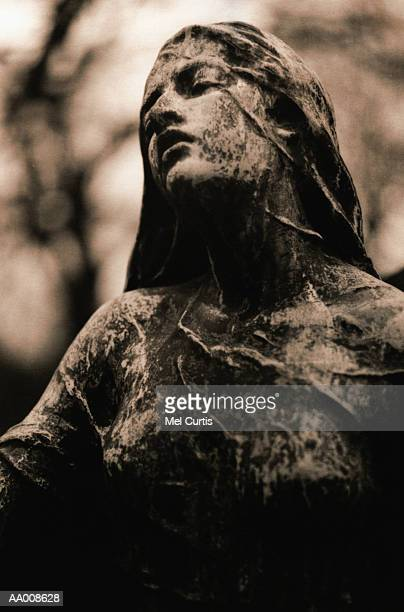 Statue in Pere Lachaise Cemetery in Paris, France