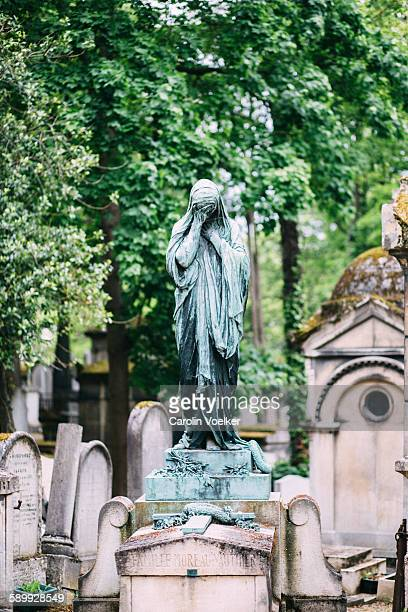 Statue in Père Lachaise cementary in Paris