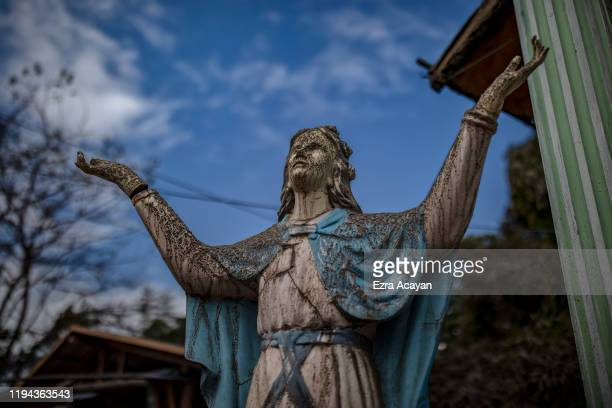 A statue is seen covered in volcanic ash from Taal Volcano's eruption on January 18 2020 in Tanauan Batangas province Philippines The Philippine...