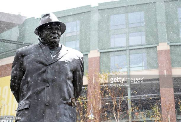 A statue is seen in the snow before a game between the Green Bay Packers and the Arizona Cardinals at Lambeau Field on December 2 2018 in Green Bay...