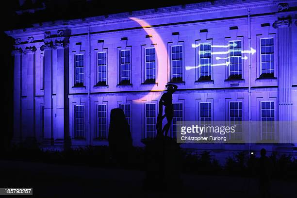 Statue is sillouhetted against the facade of Chatsworth stately home as it is illuminated as part of the Luminaire event at Chatsworth House on...