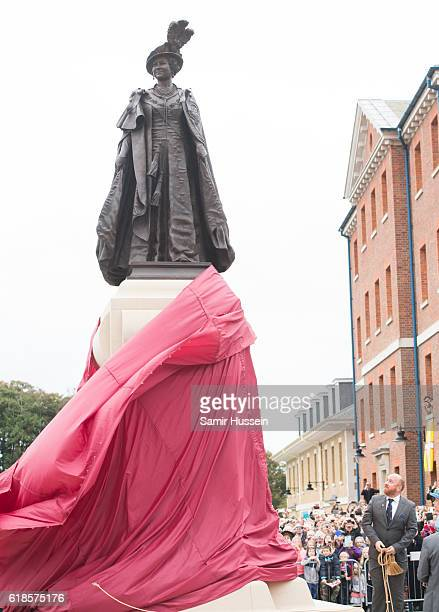 Statue is unveiled of the Queen Mother by Queen Elizabeth II at Queen Mother Square on October 27, 2016 in Poundbury, Dorset.