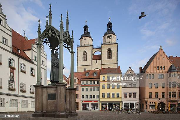 A statue of 16thcentury theologian Martin Luther stands on Marktplatz square near the Stadtkirche Sankt Marien church where nearly 500 years before...