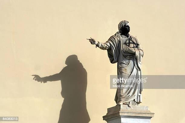 A statue of 19th century Christian Orthodox patriarch Pope Gregory V stands graffitied with black spray paint and anarchic symbol during renewed...