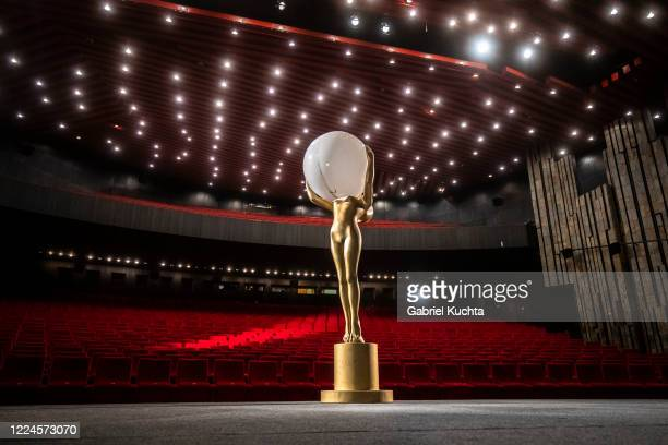 Statue of a crystal globe is set on stage in the empty movie theater during the shooting of a special opening ceremony broadcast to all cinema...