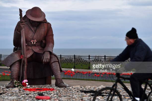 TOPSHOT A statue of a First World War soldier known locally as Tommy is seen at first light at Seaham north east England on November 11
