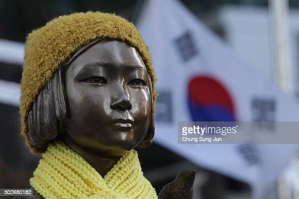 """Statue of a girl symbolizing the issue of """"comfort women"""" in front of the Japanese Embassy on December 28, 2015 in Seoul, South Korea. South Korean..."""