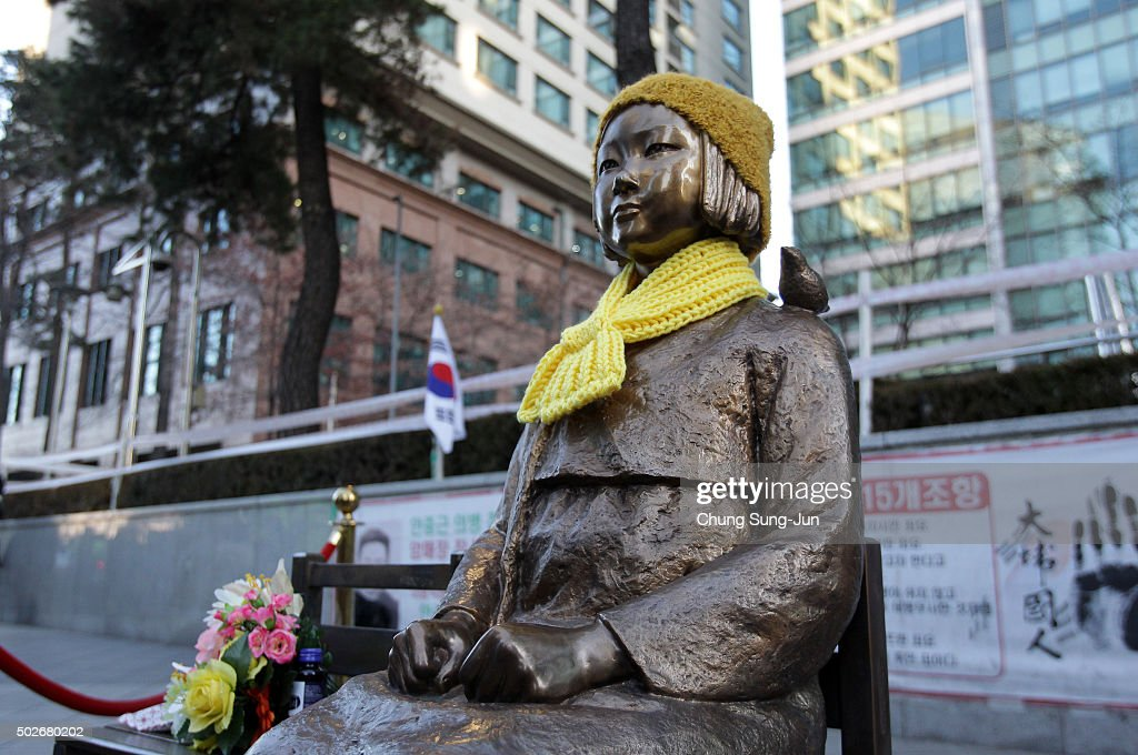 A statue of a girl symbolizing the issue of 'comfort women' in front of the Japanese Embassy on December 28, 2015 in Seoul, South Korea. South Korean Foreign Minister Yun Byung Se and Japanese Foreign Minister Fumio Kishida met to discuss the issue of Korean 'comfort women' in Japanese military brothels before and during World War II.