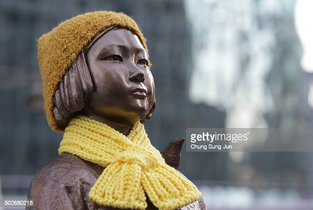 A statue of a girl symbolizing the issue of comfort women in front of the Japanese Embassy on December 28 2015 in Seoul South Korea South Korean...