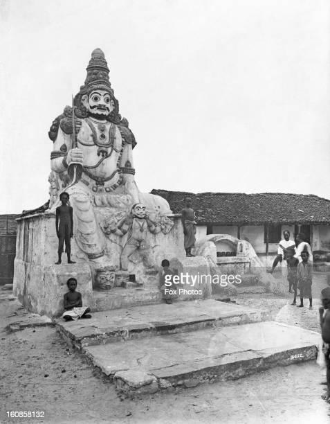 A statue of a Hindu deity at a temple in Chennai India circa 1929