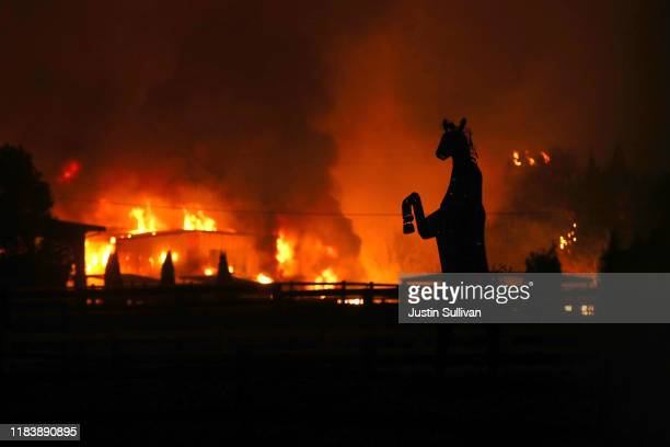 A statue of a horse stands in front of a structure burned by the Kincade Fire on October 27 2019 in Santa Rosa California Fueled by high winds the...