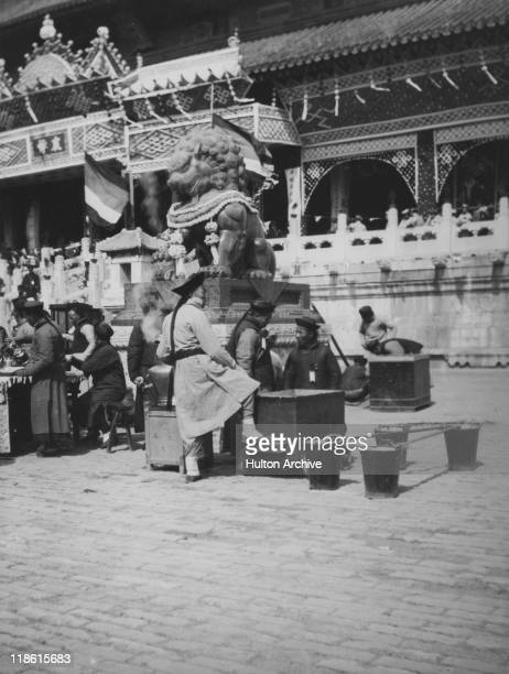 A statue of a lion in Peking later Beijing circa 1908 Photograph probably taken during the lyinginstate of the Dowager Empress Cixi
