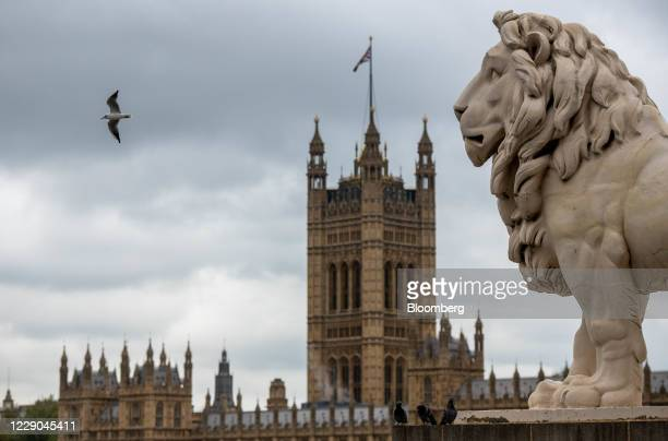 Statue of a Lion stands on Westminster Bridge in the view of the Houses of Parliament in London, U.K., on Tuesday, Oct. 13, 2020. U.K. Prime Minister...