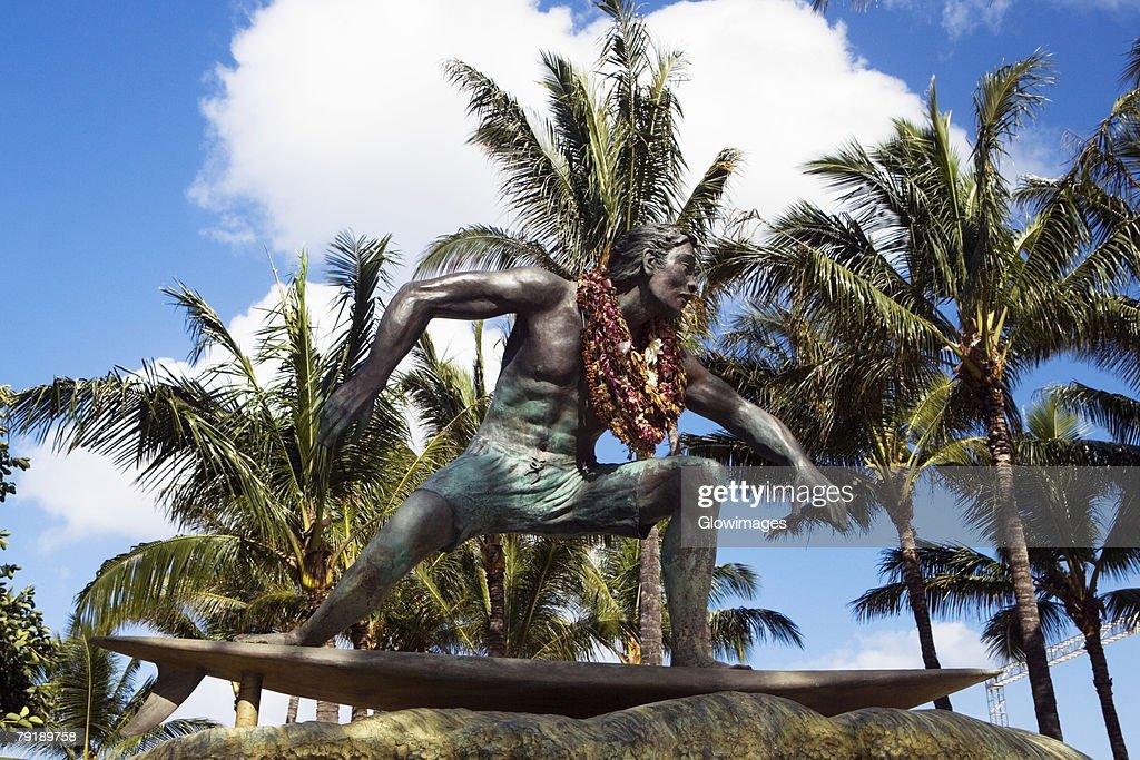 Statue of a man on a surfboard, Waikiki Beach, Honolulu, Oahu, Hawaii Islands, USA : Stock Photo