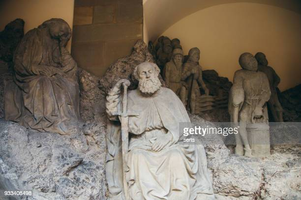 statue of a man outside st james church in rothenburg - social history stock pictures, royalty-free photos & images