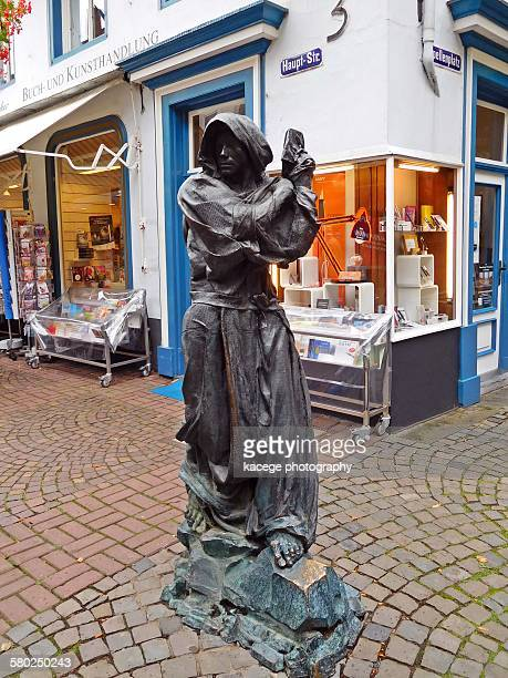 statue of a pilgrim, kevelaer - religious dress stock photos and pictures